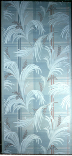 Large palm leaves and branches are loosely arranged over a plaid background of red, pink, blue, grey, beige and white on a pale aqua ground.