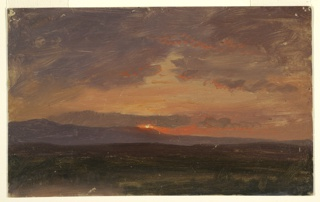 Horizontal view of setting sun behind the Catskill Mountains, which are seen from across the valley.