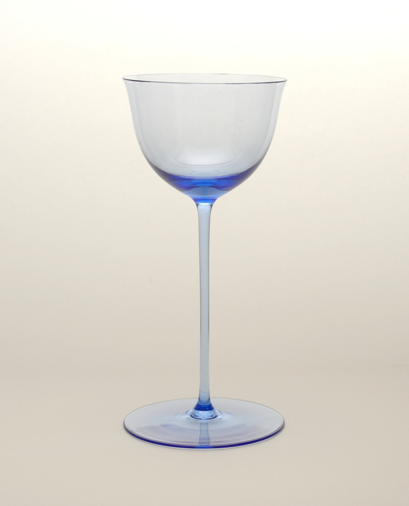 "Thin blown crystal (""Muslin glass"") wine glass with thin, long stem and relatively large round base."
