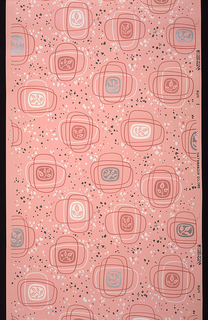 Leaf motifs surrounded by large rectangular overlapping shapes on a background of splattered dots. Rose, white, metallic silver on a pink ground.