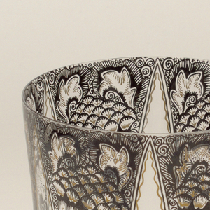 Mouth-blown crystal water tumbler, with black pen painting and gold decoration in the manner of the Steinschonau school of Northern Bohemia.