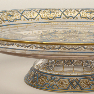 Enameled with blue, white, and gold foliate design, possibly of Near Eastern influence.
