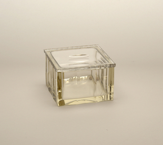 Facet-cut and polished square box with lid.