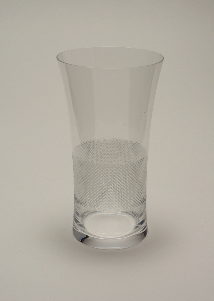 Slightly everted cylindrical form, with hand-engraved cross-hatch pattern at waist.