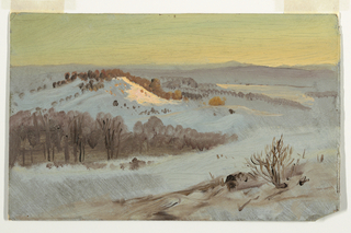 Horizontal view of a snow covered valley under a clear sky at sunset or sunrise.  A wood and hill are shown in the left middle plane; a mountain range is in the background.
