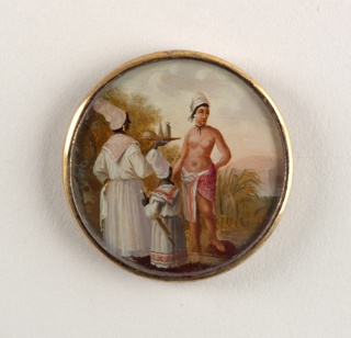 Button depicting scene of three figures in a garden. A light-skinned woman, nude but for a shawl around her waist, stands before a servant in a white dress holding a tray with bottles and a female child also in a white dress holding a parasol.