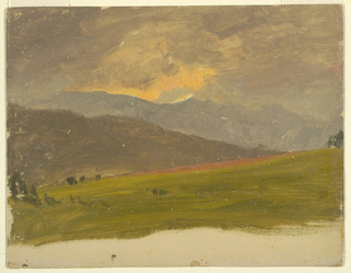 View of steep hills sheltering a small valley, devoid of heavy vegetation.  Low-lying clouds glow pink in the sunset.  Dark hills rise in the left foreground.