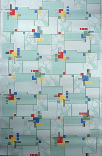 Cubist design. Red, blue, and yellow Mondrian type squares on a background of light green and marbleized green squares with metallic silver on a cream ground.