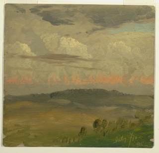 Horizontal view over wooded hills under a clloudy sky, with a patch of blue, one stripe reddened.