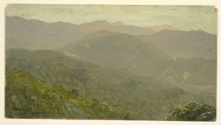 View of a mountain range and peaks across wooded valleys.