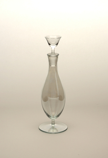 "Thin blown crystal (""Muslin glass"") rum flacon and stopper.  Bell-shaped body on a small stem and circular base.  Circular stopper reflects overall shape of base, body, and top."