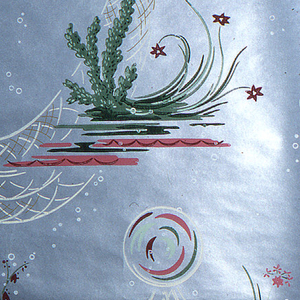 Bathroom paper of pink and white bubbles, coral, and fish net on a metallic silver ground.