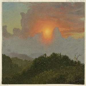 Setting sun over hilly country.