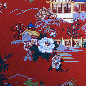 Chinese motif of pagodas and white flowers on a coral, red ground.