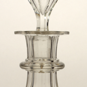 Mouth-blown crystal decanter, broad-cut and polished facets and teardrop stopper.