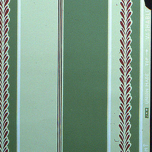 Stripes in shades of green with white stripe and maroon bay leaf design on white ground.