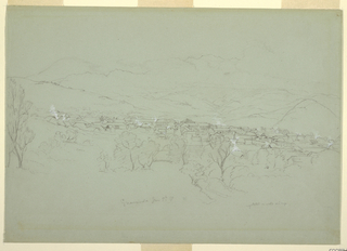 A vilage is shown in a valley in front of mountains. In the distance is a hight mountain range. 