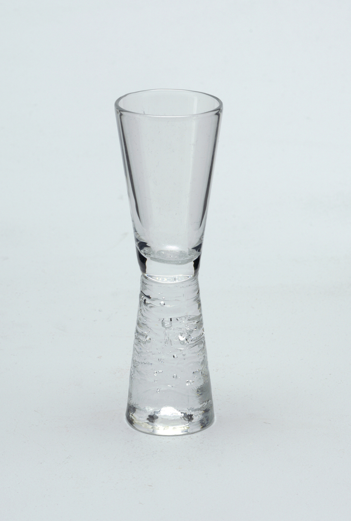 Clear glass with inverted tapered stem with horizontal ridged design.   Sherry