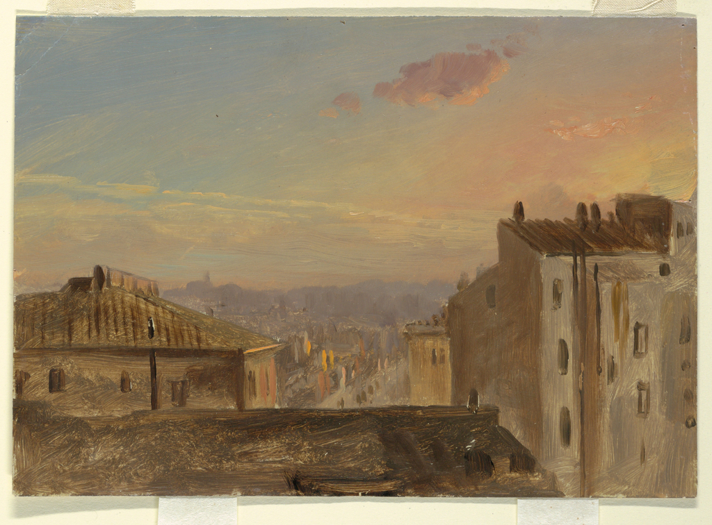 Hortizonal image of a roof top view of the city of Rome.  The sun is over the horizon.  People are shown upon the street, light clouds in the sky.