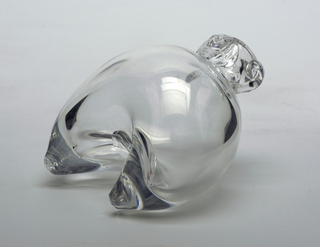 Clear glass bottle.  Bulbous cresent shaped bottle with short neck.  Semi-circular handles at neck, glass face at neck of bottle.