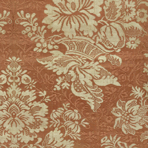 Length of woven silk with a vertically symmetrical design of baskets of flowers, in white on a rust ground. Interstices filled with floral vine in same color as ground.