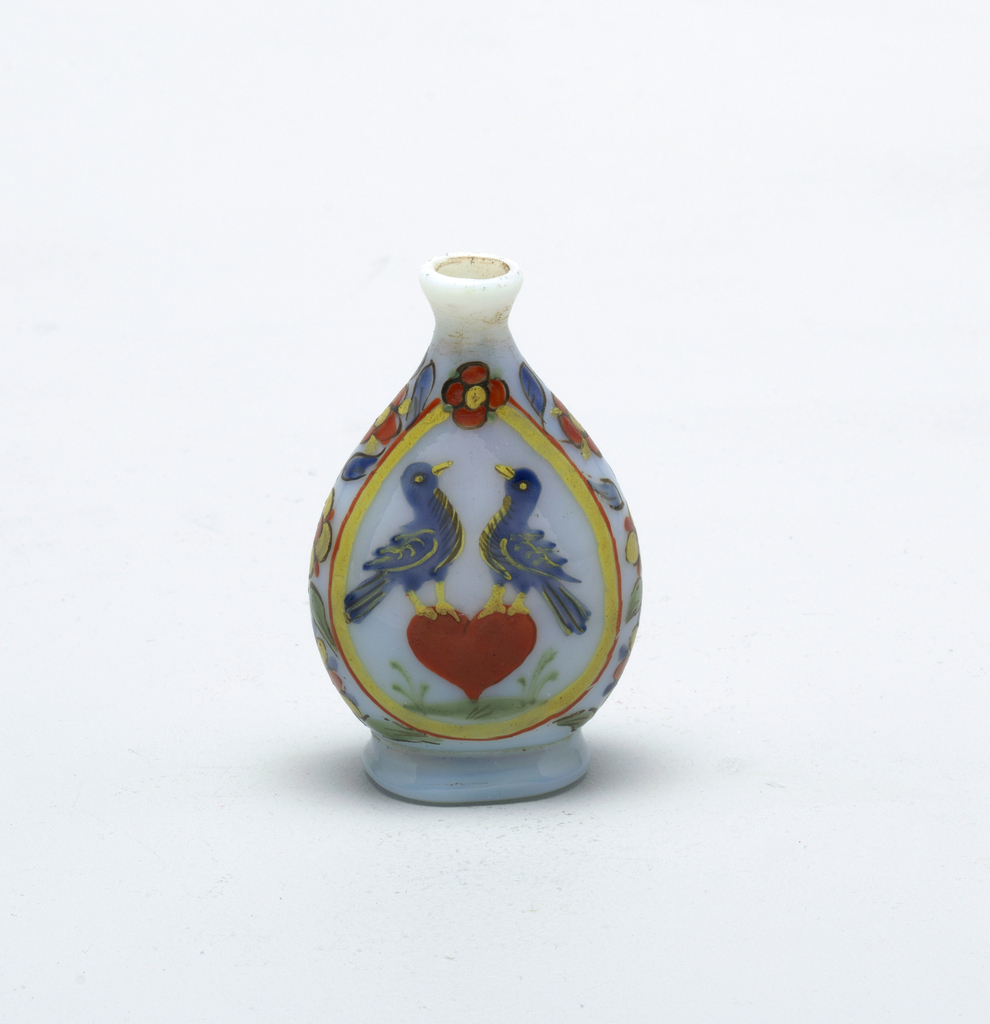 Opaque white flask with slight blue cast.  Painted love birds central figure