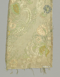 Length of woven silk with lace-like serpentine bands framing symmetrical floral elements in pastel colors on an off-white ground.