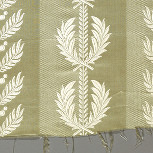 Pattern of alternating stripes in plain and fancy satin weave with leaf forms superimposed. Both warps and wefts of same off-white color. Pattern achieved only by variation on weave.