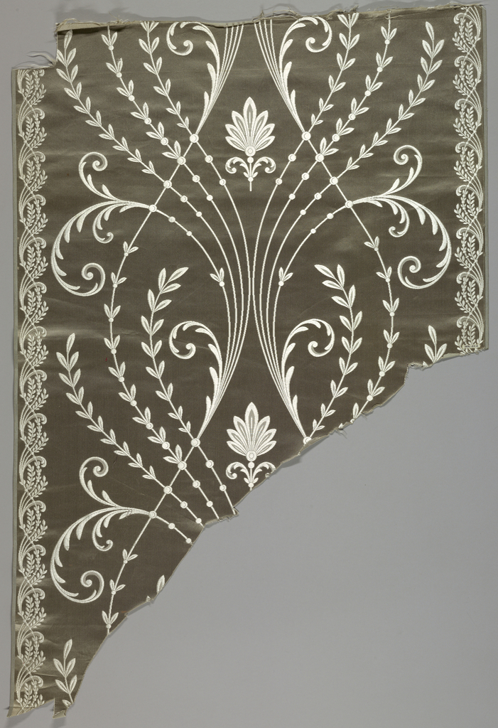large scale design of slender stems in white on grey.