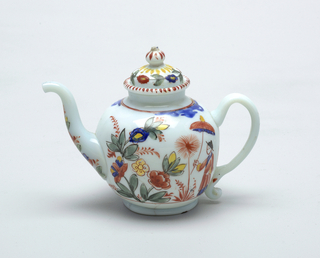 White glass with slight blue cast.  Painted decoration with Chinoiserie style.  Woman with parasol central figure on either side of teapot.  Teapot has old repairs.