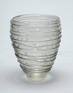 Clear glass vase, inverted beehive shape.