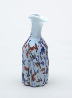 Light blue glass with cobalt blue glass decoration.
