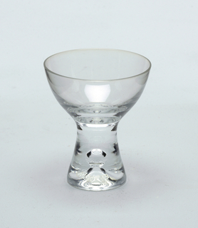 Clear glass with pronounced central air bubble in solid glass stem.  Sherry or dessert wine