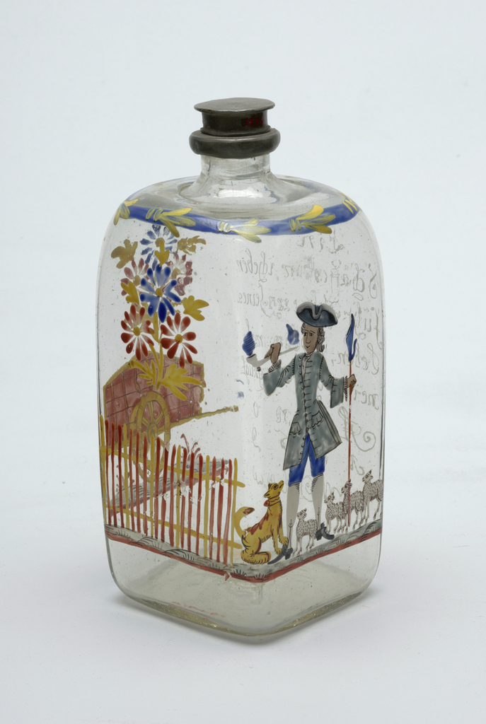 Clear glass bottle with painted shepherd, bottle has squarish shape