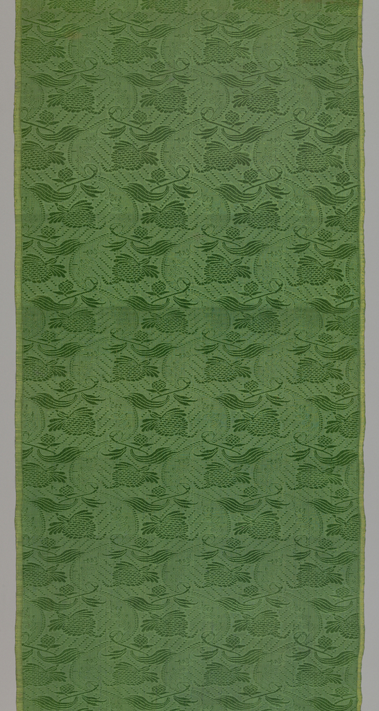 Four lengths of a textile with offset rows of a flower on a stem (alternate rows counter faced) with a leaf-like ribbon curving through the rows. Green pattern on green background.