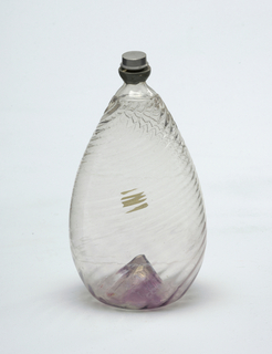Clear glass tear-drop shaped bottle with silver cap.  Glass has swirling ridges, slight lilac color at bottom of bottle