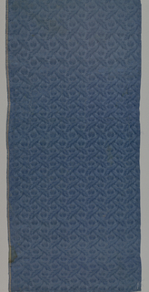 Silk panel in dull blue with a small allover pattern of serpentine leaves and flowers.