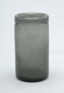 Grey glass.  Wide cylindrical form.
