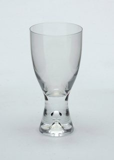 Clear glass with pronounced central air bubble in solid glass stem.  White wine