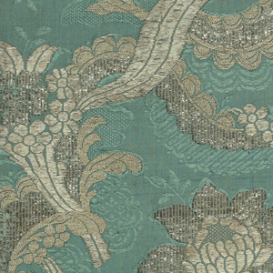 Blue-green grosgrain with silver brocaded design of looping and interlacing serpentine ribbon and lace. Floral sprays caught in serpentine. Five complete and one incomplete width sewed together.