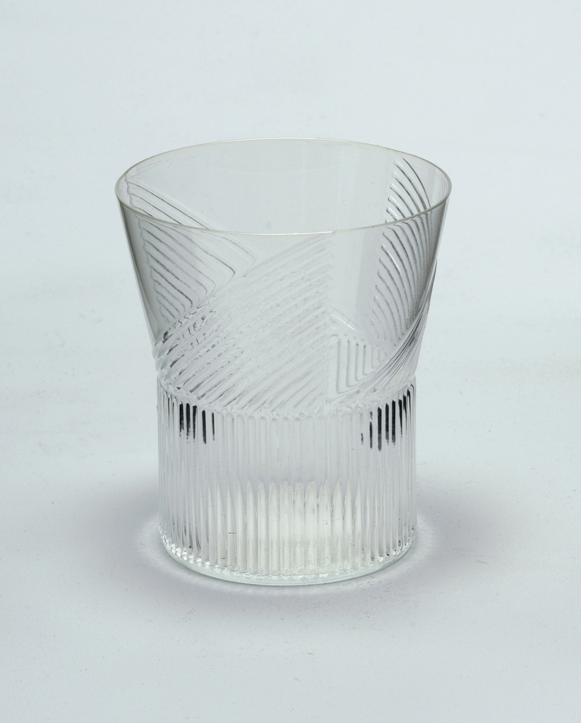 Mold-blown glass with vertical ridge pattern on wide cylindrical stem.  Ridge pattern continues on vessel in a triangular format (3).  Red wine.