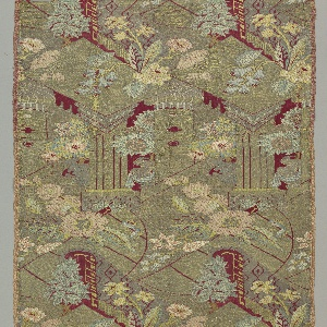 Fragment composed of two pieces of silk in the 'bizarre' style. Design shows a column form alternating with a flower vase with swag, and large florals in pink, blue and yellow.  nk flowers and a spiral column. Rich use of gold and silver with limited brocaded silk colors. Red-orange foundation fabric limited to linear details or small areas of background. Silver and gold tarnished.