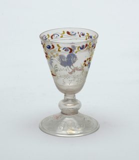Clear glass goblet with painted decoration.  Blue rooster central figure.