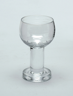 Bell-shaped cordial glass with stem and foot.