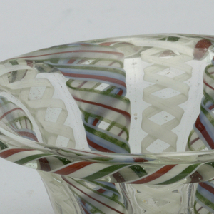 Green, red, white and blue glass in a vertical twisted ribbon pattern.