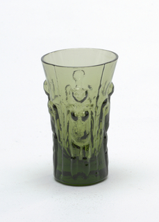 Dark green glass bottle and cork stopper with 3 glasses.  Vertical male and female figures in low relief decoration on all glass
