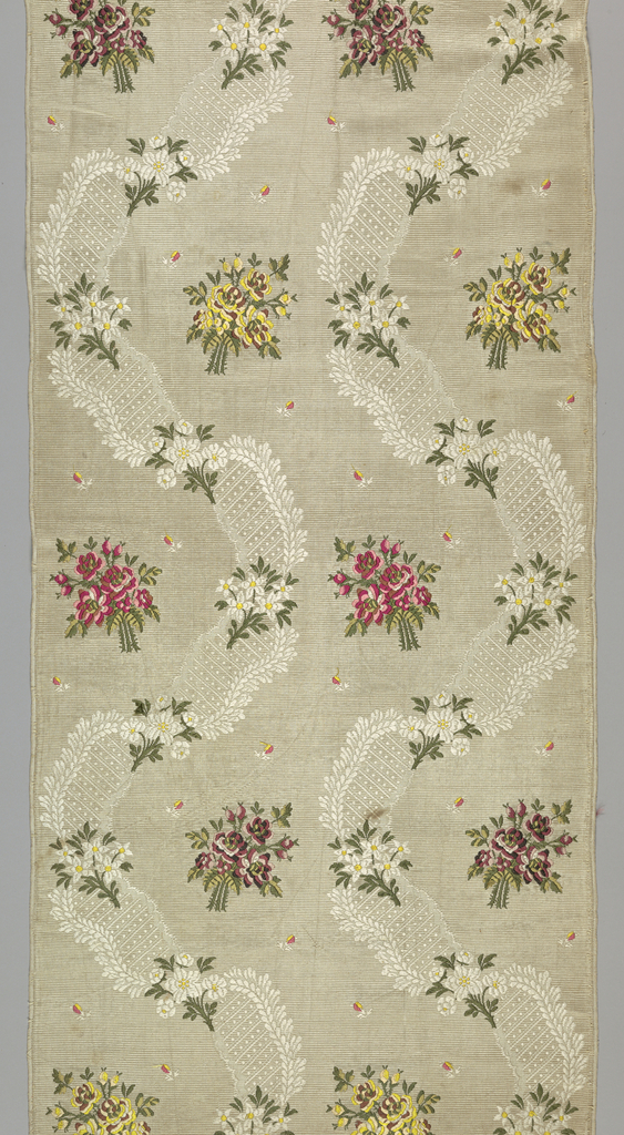 Nineteenth century machine-made copy of Louis XV-style fabric. Cream ribbed silk with wavy S-shaped ribbons and brocaded floral clusters in several color combinations: red, pink and green; yellow, cream and brown; and yellow and white. Scattered buds throughout in yellow and coral.
