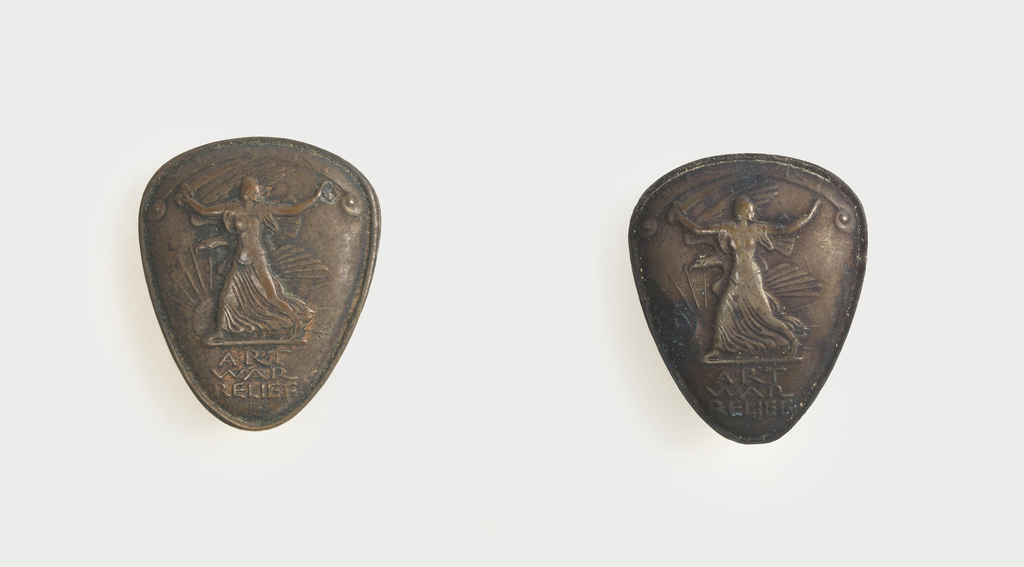 "One patinated bronze triangular mounted plaque (-1a) in original case; three small triangular bronze pins (-1b/d). Each showing classical female figure in phrygian cap, holding sword above her head and striding before rising(?) sun and eagle in flight; inscribed ""Victory (in banner above figure), Art, War, Relief"""