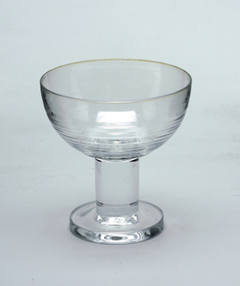 Bell-shaped champagne glass with stem and foot.