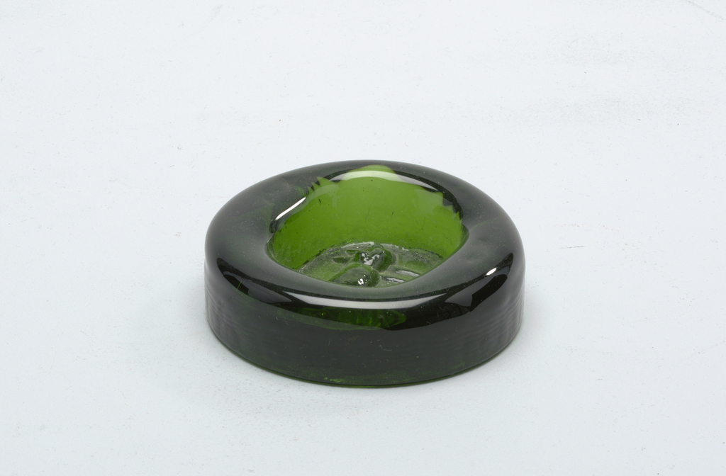 Green glass.  Circular form.